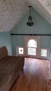 Attic awaiting drapery panels!  Has a new floor walls, ceiling, chandelier...