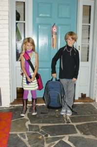 Yep, these are the kids on their first day of school.  I have one incredible artist and a one super smart jock.  Notice the paper fish sail adorning our door!